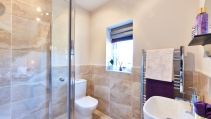Tiled ensuite bathroom at HighFields