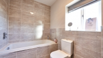 Fully tiled bathroom at HighFields